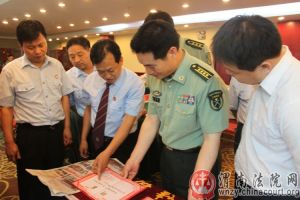 Head of Lanzhou Military District Court visiting local intermediate court